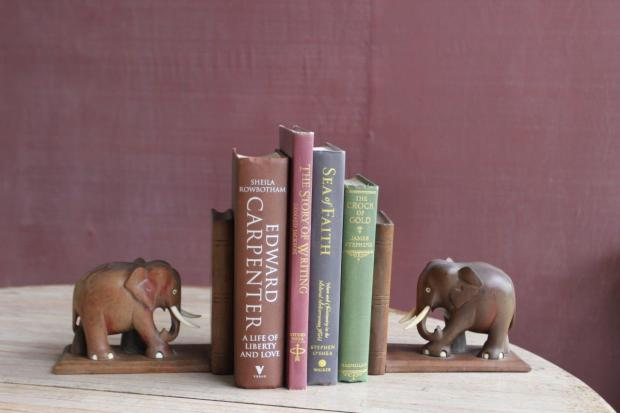 Since the elephants in this photo are looking toward the books they are holding, they are very appropriate for a freestanding book arrangement.