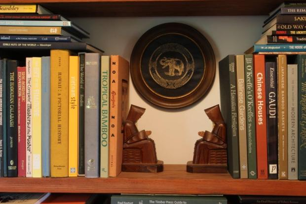 When used in shelving, the monk bookends are perfect to create a break in what would otherwise be a wall of books. Here they create space for a framed elephant brocade, and happily, the monks are looking toward each other.