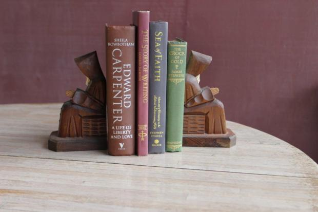 These monk bookends are not appropriate for a freestanding arrangement because that makes them look away from each other.