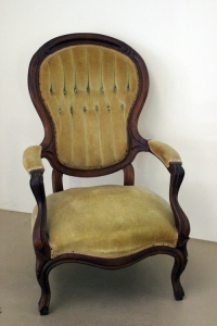 This American-made Victorian chair from the mid-1800s has a rounded back—representing the Turtle behind—and the two nicely padded arms represent the Tiger and Dragon. It originally had metal rollers, which made it look disconnected from the floor. We removed those, boxed, labeled and stored them away. If you can easily take an old chair (or couch) off its rollers, then do so. You'll have a much more grounded piece of furniture.